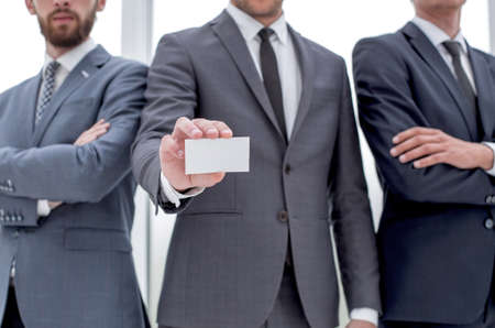 business team leader showing business card