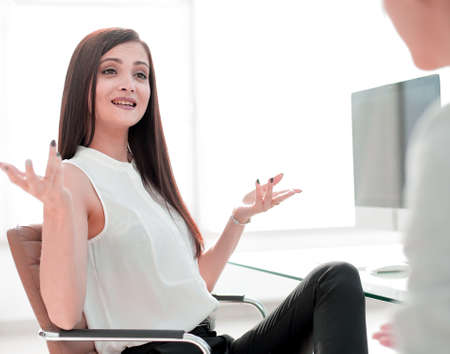 two business women talking in the workplace