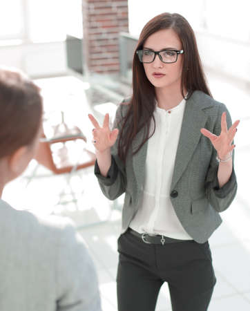 business woman talking to an office worker
