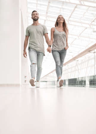 modern couple walking together.