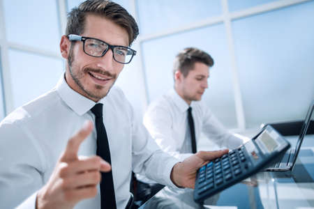 young accountant holding a thumb up and smiling