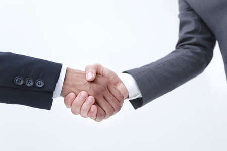 Conceptual picture of businessmen shaking hands isolated background Reklamní fotografie
