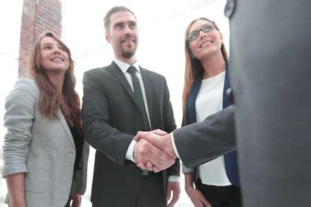 businessmen shaking hands in conference room