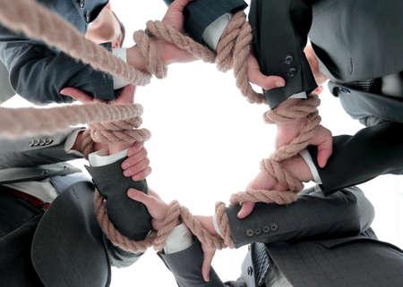 closeup.business team holding strong rope. Stock fotó