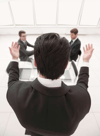 rear view.businessman refers to colleagues in the conference room Imagens