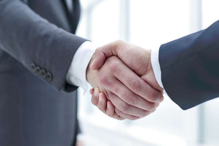 close up.handshake business partners.