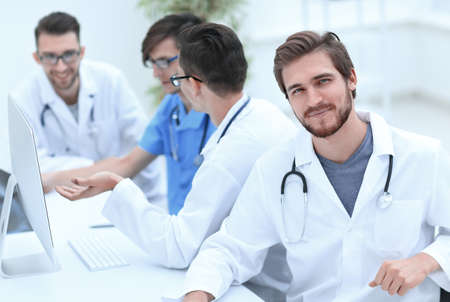 smiling doctor on the background of the medical offic