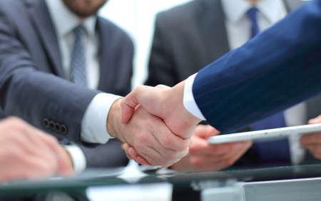 Close-up image of a firm handshake. Фото со стока