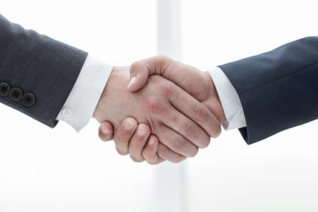 close up.handshake of business partners on a light background.concept of cooperation
