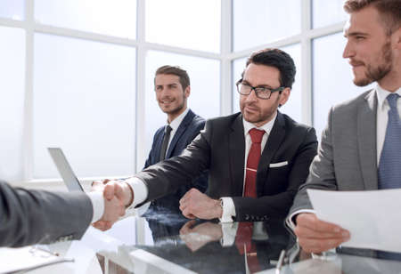handshake of business people at a working meeting