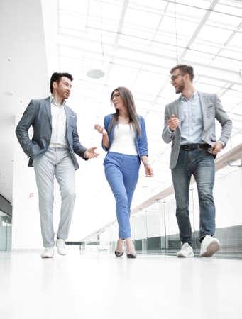 Business people walking in the office corridor