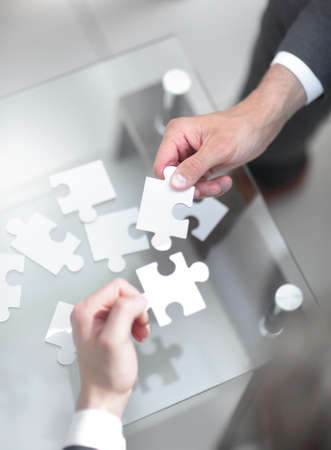 business partners put the pieces of the puzzle.