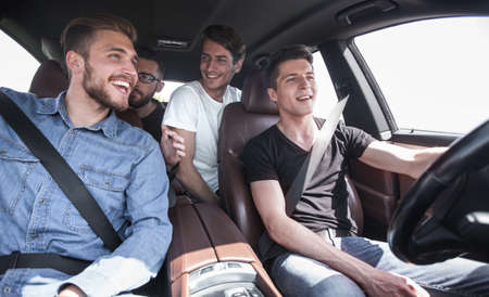 close up. a group of young people sitting in the car Stok Fotoğraf