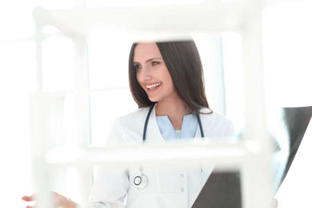 close up.smiling woman doctor with x-ray of patient 写真素材