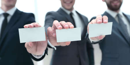 three business partners showing their business card form
