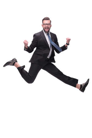 in full growth. happy dancing young businessman Stock Photo