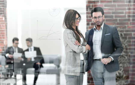 business couple standing in a modern office Foto de archivo