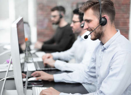 employees with a headset in the workplace in the business center