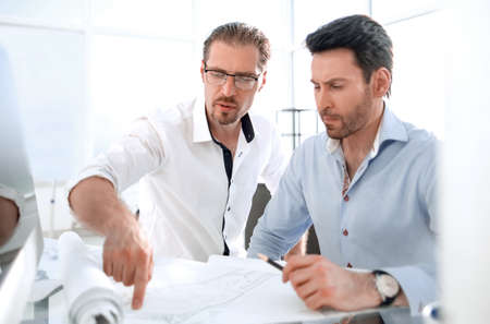 two architects discussing the project in the office