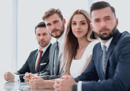 business people sitting at the Desk