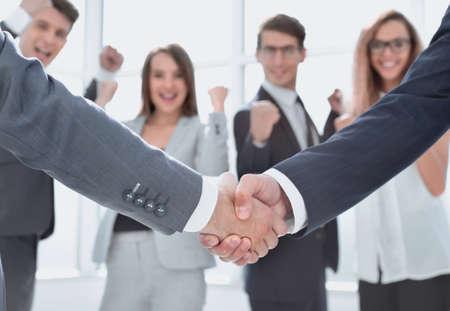 close up.handshake business partners on blurred office background Banco de Imagens - 128440126