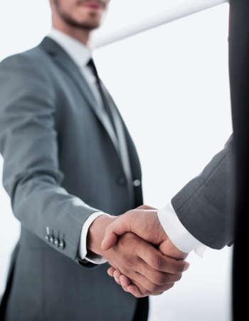 Happy businessman making handshake with businesswoman at meeting Banco de Imagens