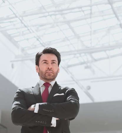 confident businessman standing in a spacious office