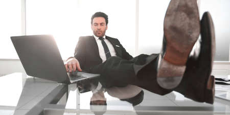 successful businessman relaxes in his office