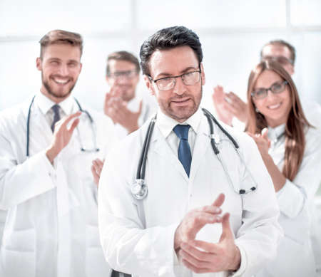 successful doctor, accepting congratulations from colleagues