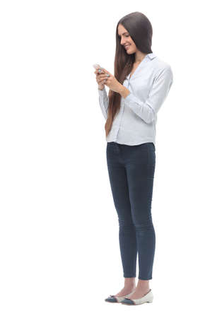 young woman reading a conversation on her smartphone. isolated on white Imagens