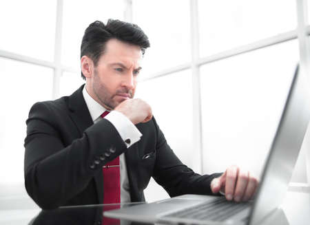 Businessman sitting at his Desk.business and technology