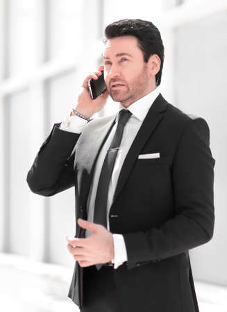 handsome businessman talking on a smartphone.