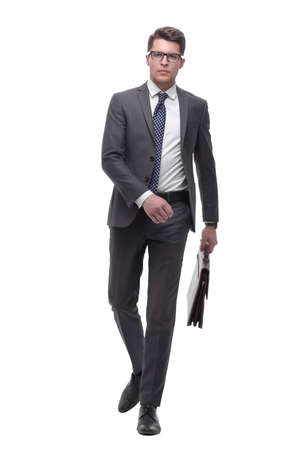 successful businessman with leather briefcase stepping forward