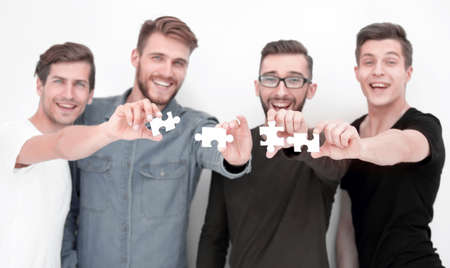image of the guys connecting pieces of the puzzle