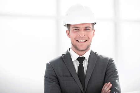 builder in a helmet smiles