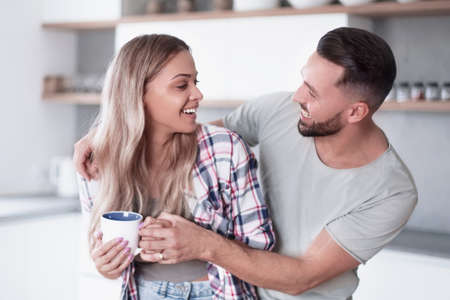 happy young couple in kitchen in good morning time Zdjęcie Seryjne