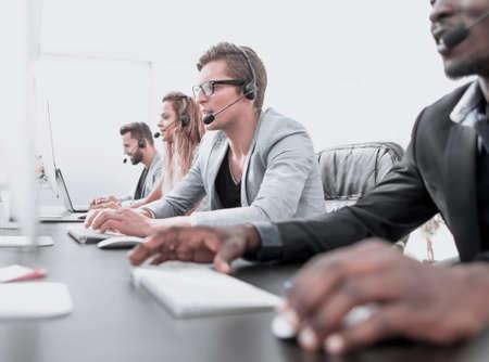 call center staff work in a modern office Фото со стока