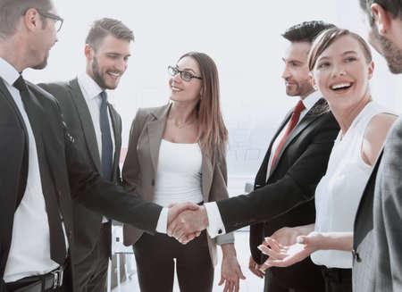 Business handshake in a modern office