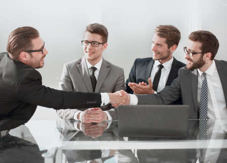 employees greet each other with a handshake