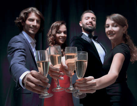 Cheerful people celebrating a sucess with Champagne Banco de Imagens - 129306276