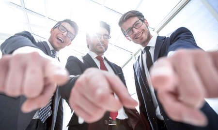 We choose you! three business men pointing at you
