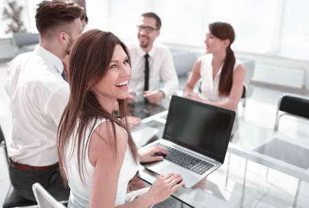 young business woman working on laptop in office. Stock Photo