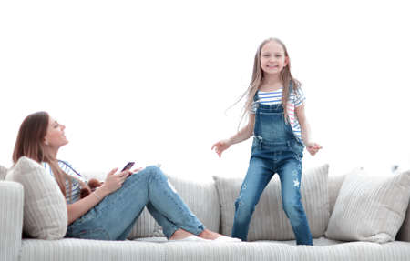 little girl jumping on the couch on the couch in the living room