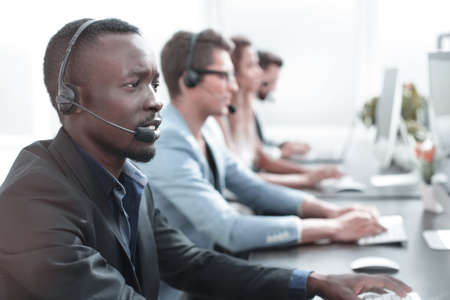 close up.call center operator on the background of colleagues Stock Photo