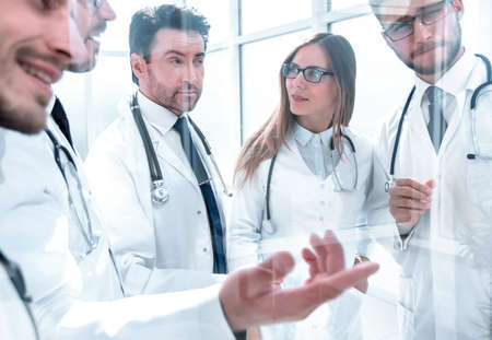group of doctors discussing the patients x-ray