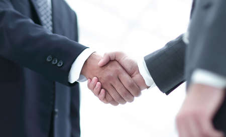 Close up image of business handshake at meeting. 写真素材