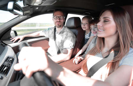 happy family travels in a comfortable car