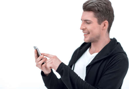 successful young man typing SMS on smartphone Imagens