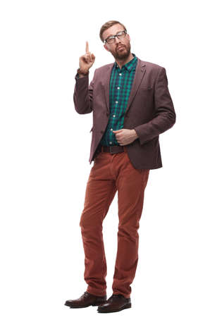 polite hipster man pointing finger up . isolated on white