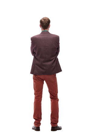 rear view. young man standing in front of white blank screen